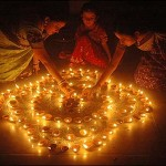 Girls lighting diyas