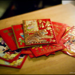 Red Envelopes containing money are given at CNY