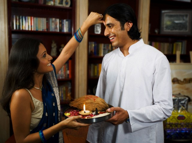 A Diwali Custom: Sisters greet brothers by applying Tika to their forehead